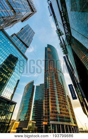 MOSCOW - AUGUST 10, 2016: Low angle view of Moscow-City skyscrapers at sunset. Moscow-City (Moscow International Business Center) is a modern commercial district in central Moscow.
