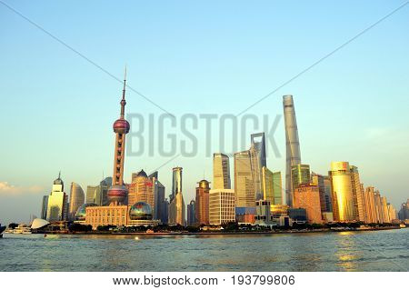 Shanghai, July, 12.  Shanghai skyline. Pudong District seen from the Bund and Huangpu River in Sunset, July 12, 2015. Shanghai, China.