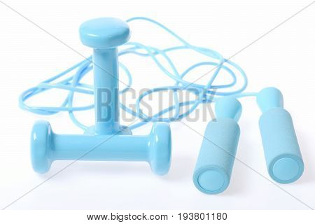 Dumbbells In Turquoise Colour Put Crosswise Near Cyan Skipping Rope