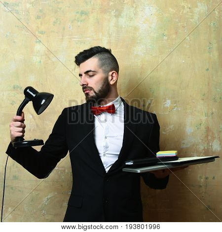Broker With Neat Beard And Satisfied Face Expression Holds Lamp