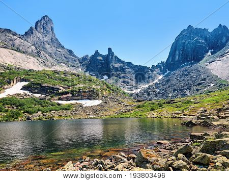 Mountain Lake Against Backdrop Of Ridge. June. Ergaki. Krasnoyarsk Region. Russia