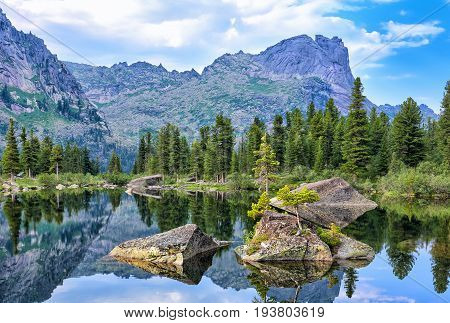Large Fragments Of Rock In Water Of Mountain Lake