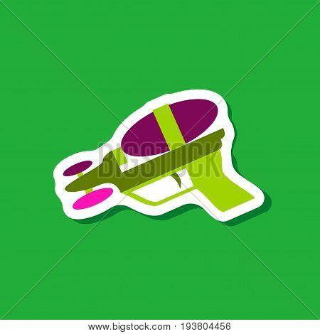 paper sticker on stylish background Toy gun