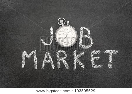 job market phrase handwritten on chalkboard with vintage precise stopwatch used instead of O