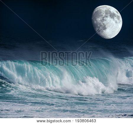 a big sea wave and Tne Moon - close up