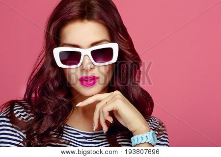 Woman in sunglasses close-up, studio. Beauty, fashion and personal accessories. Luxury woman model with big white sunglasses and sexy bright pink lips