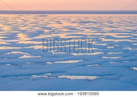 The ice field in the evening in blue pink colors