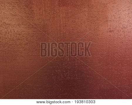 Red copper background texture with wooden sawdust particles like scratches. Brush painted wood surface. Copper red pattern background. Dark red plate copper painted wood wall. Copper color