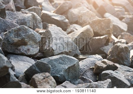 Gray stone. Scree in the sunlight. Natural stone background