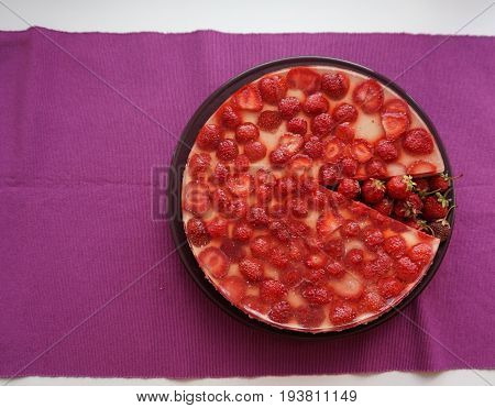 Delicious Strawberry Cake With Jello And Slice Lay On The Plate, Top View