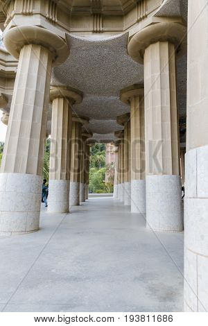 Outer line of columns under nature square at Hypostyle Room in Park Güell Barcelona