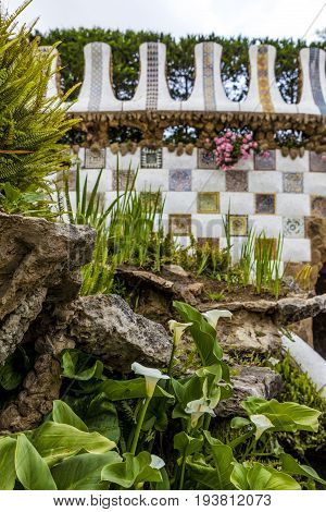 Flowers on monumental flight of steps wall background in Park Güell Barcelona