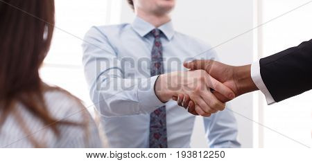 Business multiethnic handshake closeup, contract conclusion and successful agreement concept. Crop image
