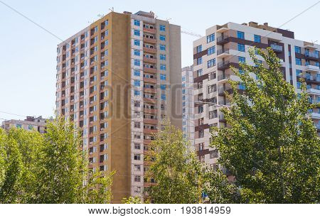 Summer day. Construction site. Construction of a multi-storey residential building