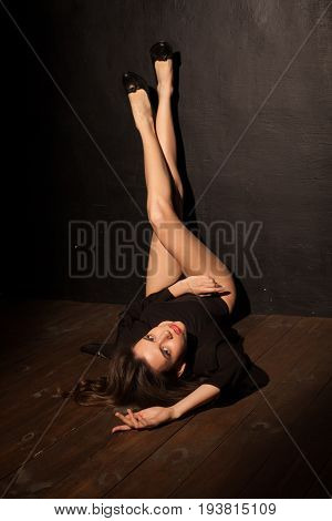 sexy girl lying on the floor lifted her legs up