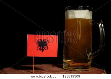 Albanian Flag With Beer Mug Isolated On Black Background