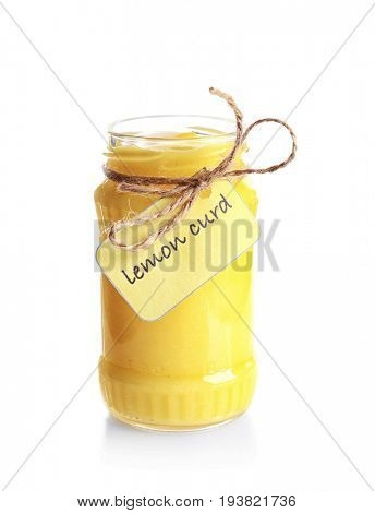 Glass jar with yummy lemon curd on white background