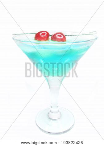 alcohol blue liqueur cocktail with ice and cherry