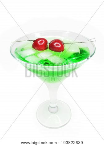 alcohol green liqueur cocktail with ice and cherry