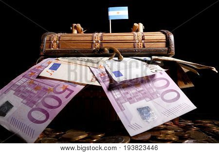Argentine Flag On Top Of Crate Full Of Money