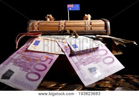 Australian Flag On Top Of Crate Full Of Money