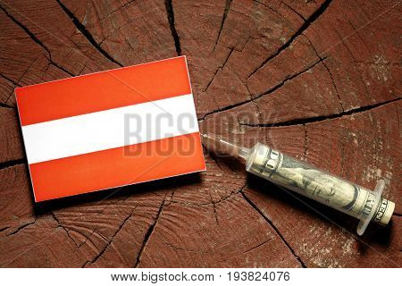 Austrian Flag On A Stump With Syringe Injecting Money In Flag
