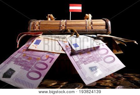 Austrian Flag On Top Of Crate Full Of Money