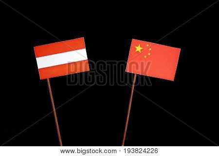 Austrian Flag With Chinese Flag Isolated On Black Background