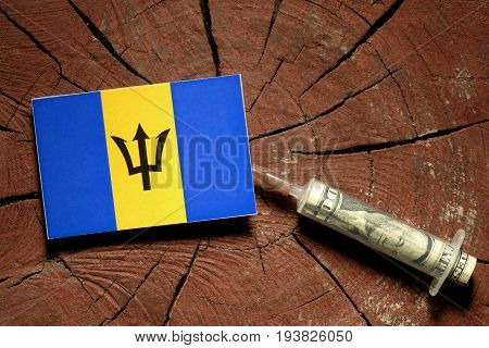 Barbados Flag On A Stump With Syringe Injecting Money In Flag