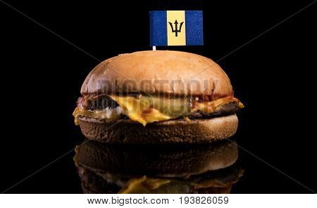 Barbados Flag On Top Of Hamburger Isolated On Black Background