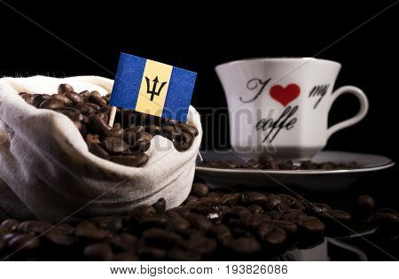 Barbados Flag In A Bag With Coffee Beans Isolated On Black Background