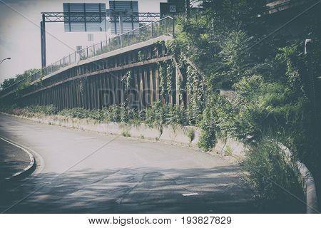 A retro photo of a bridge on a highway.