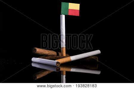 Benin Flag With Cigarettes And Cigars. Tobacco Industry Concept.