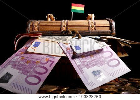 Bolivian Flag On Top Of Crate Full Of Money