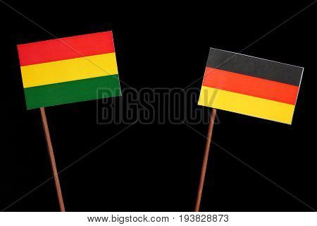 Bolivian Flag With German Flag Isolated On Black Background