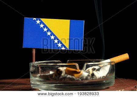 Bosnia And Herzegovina Flag With Burning Cigarette In Ashtray Isolated On Black Background