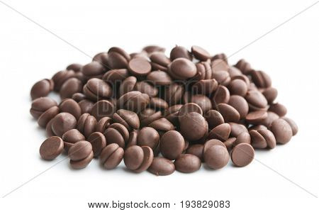 Tasty chocolate morsels isolated on white background.