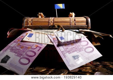 Bosnia And Herzegovina Flag On Top Of Crate Full Of Money