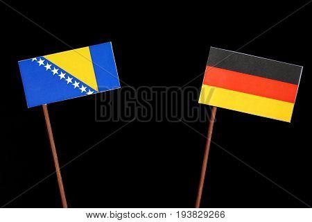 Bosnia And Herzegovina Flag With German Flag Isolated On Black Background