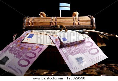 Botswanan Flag On Top Of Crate Full Of Money