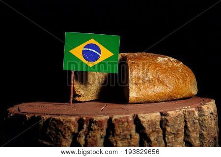 Brazilian Flag On A Stump With Bread Isolated