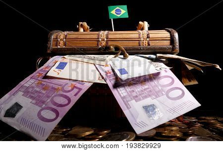 Brazilian Flag On Top Of Crate Full Of Money