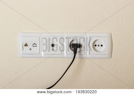 Close Up Power Outlet And Telephone Outlet And Computer Outlet In A Socket
