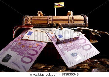 Brunei Flag On Top Of Crate Full Of Money