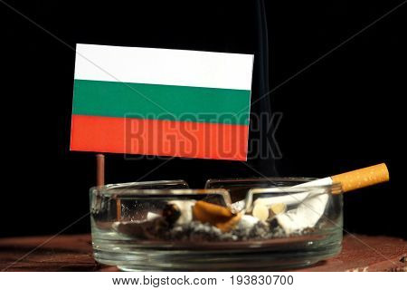 Bulgarian Flag With Burning Cigarette In Ashtray Isolated On Black Background