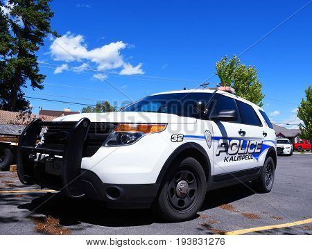 KALISPELL, MONTANA, USA - June 21, 2017: Kalispell Police Department SUV on scene with its flashing lights on in a parking lot