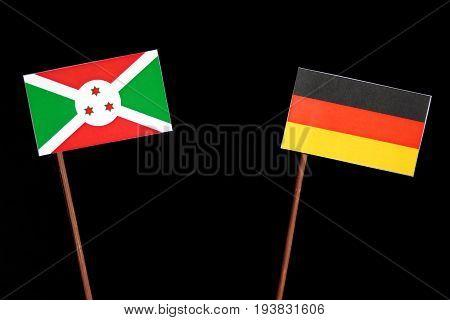 Burundi Flag With German Flag Isolated On Black Background