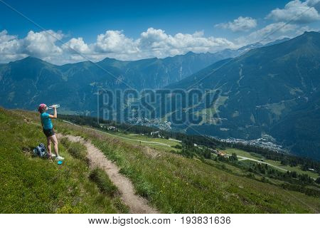 Young Woman On A Mountain Hike, Austrian Alps