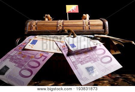 Bhutan Flag On Top Of Crate Full Of Money