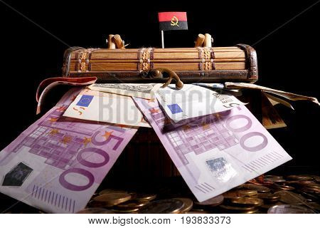 Angolan Flag On Top Of Crate Full Of Money
